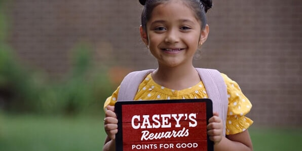 Child with Casey's Rewards Points for Good tablet