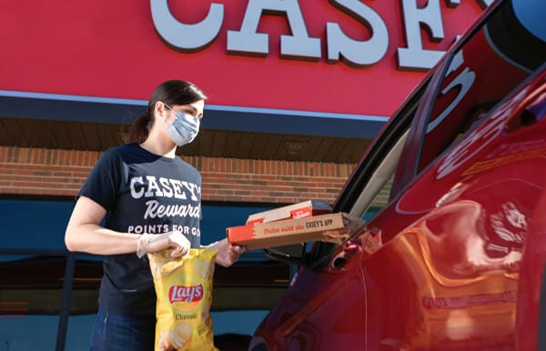 Casey's team member bringing order out for curbside pickup